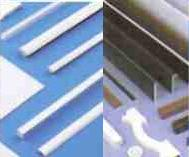 Floplast plastic window trims and architraves in White and Woodgrain effects and cavity closers.